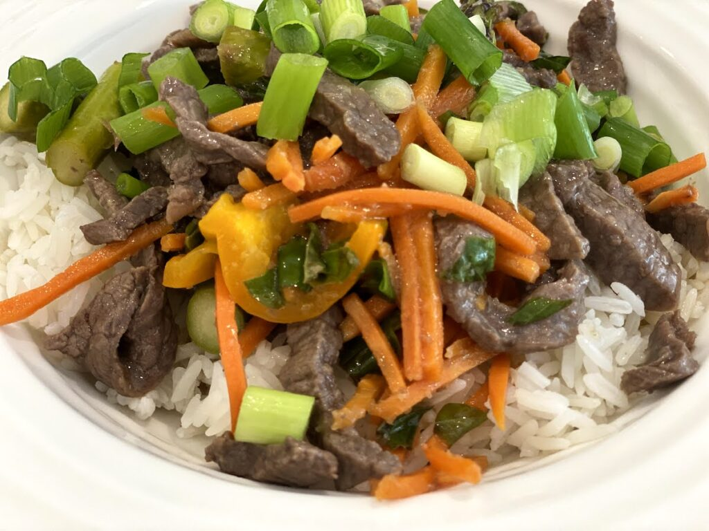 ginger beef veggie and basil stir fry over rice